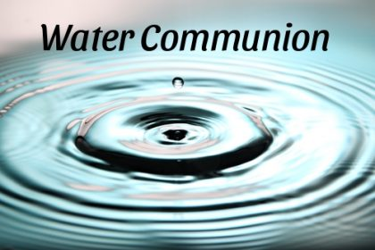 """A drop of water creates ripples underneath the text """"water communion."""""""